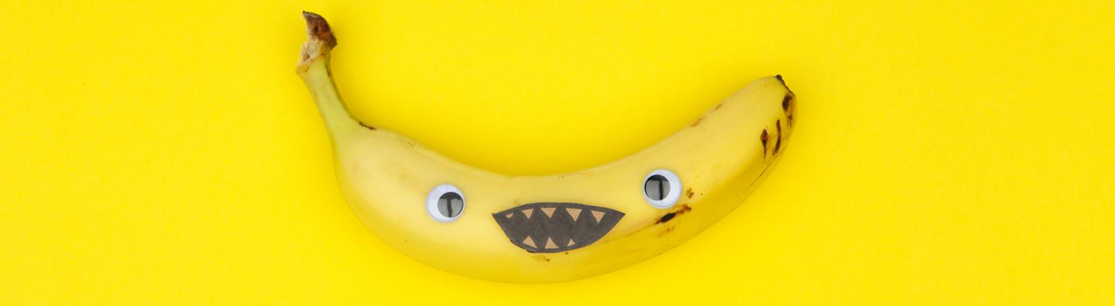 Banane mit aufgemaltem Gesicht