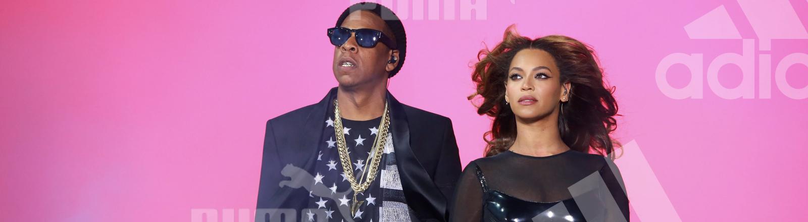Links JAY-Z, rechts Beyoncé bei einem Auftritt in Paris 2014