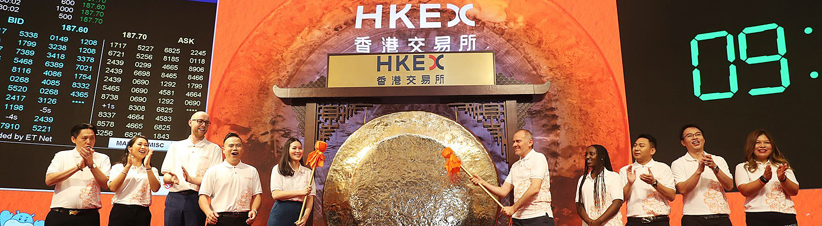 Ten global partners of Alibaba beat the gong during the Alibaba Group Holding's listing on the Hong Kong Exchanges and Clearing Market on November 26, 2019 in Hong Kong, China.