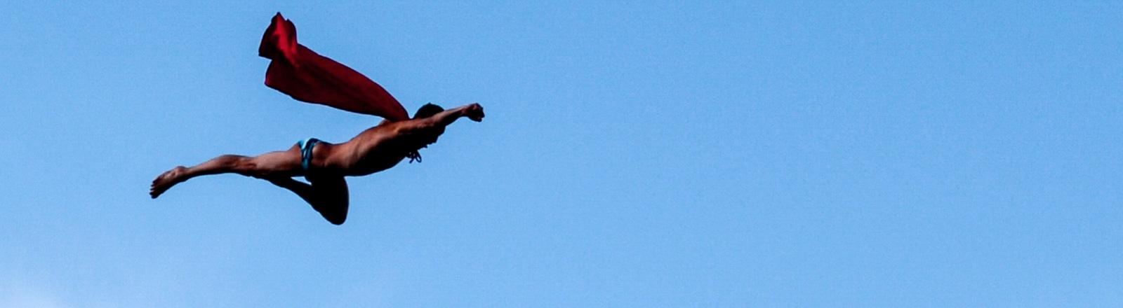 Superman fliegt durch die Luft