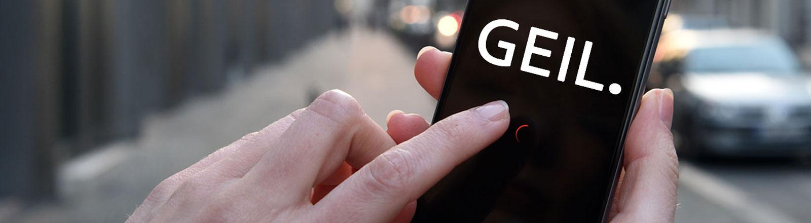 Handy mit Aufschrift GEIL