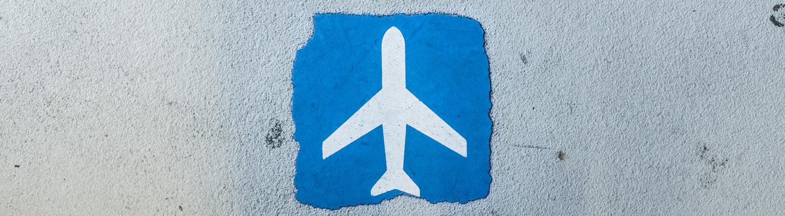 Symbol Flugzeug auf blauem Grund