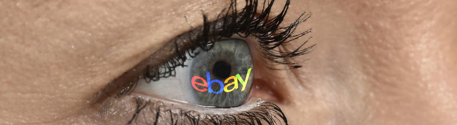 Ebay-Schriftzug, projiziert auf weibliches Auge