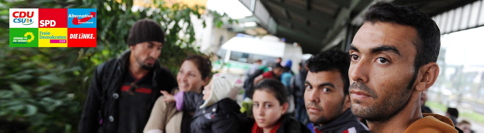 Flüchtlingsfamilie am Bahnhof