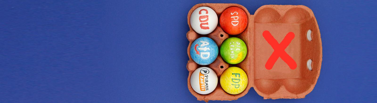 Bemalte Eier mit Parteien-Logos im Eierkarton