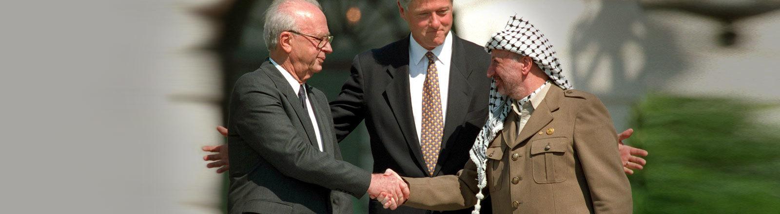 Yitzhak Rabin, Bill Clinton und Jassir Arafat