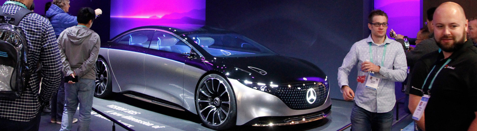 Attendees take a closer look at the Mercedes-Benz Vision EQS concept vehicle on display during the 2020 International CES, at the Las Vegas Convention Center in Las Vegas, Nevada.