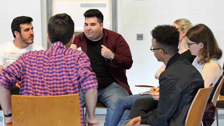 Mulla Cetin (Mitte) bei der Jungen Islam Konferenz 2018