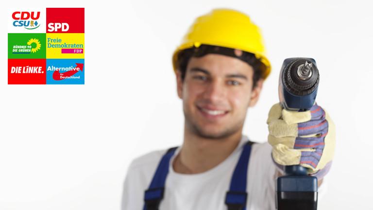 Bauarbeiter mit Bohrmaschine