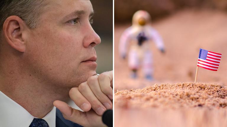 James Bridenstine, Astronauten-Figur mit US-Flagge auf Sandhaufen