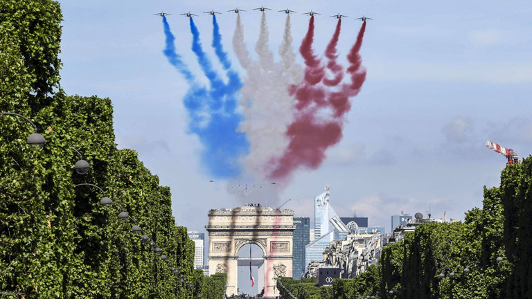 Paris, France - U.S. F-35 Fighter aircraft and the USAF Thunderbirds perform a flyby over the Arc de Triomphe during the annual Bastille Day military parade July 14, 2017