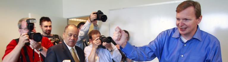 Jim Messina vor der Presse