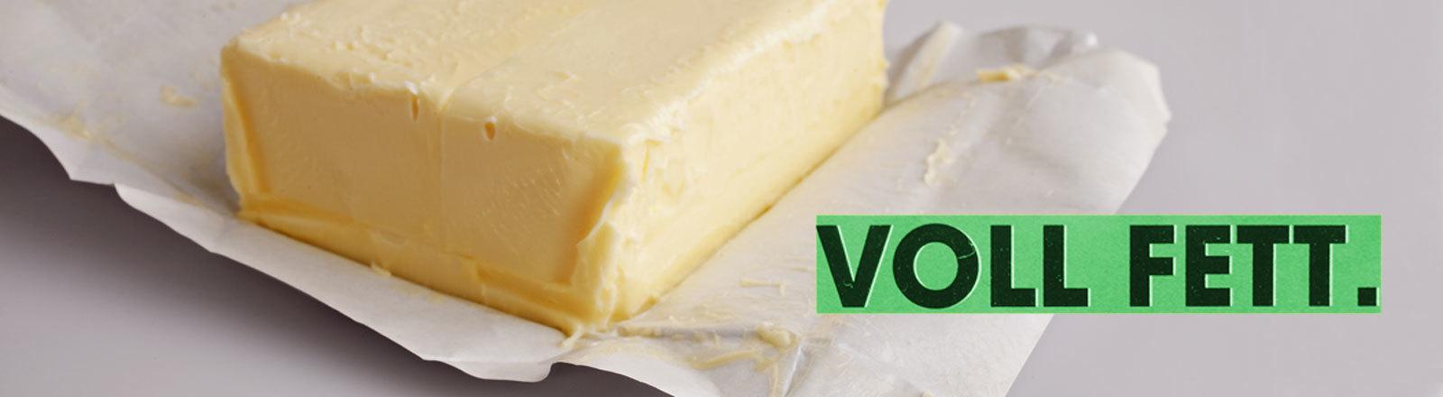 """Stück Butter mit Schriftzug """"Voll Fett"""""""