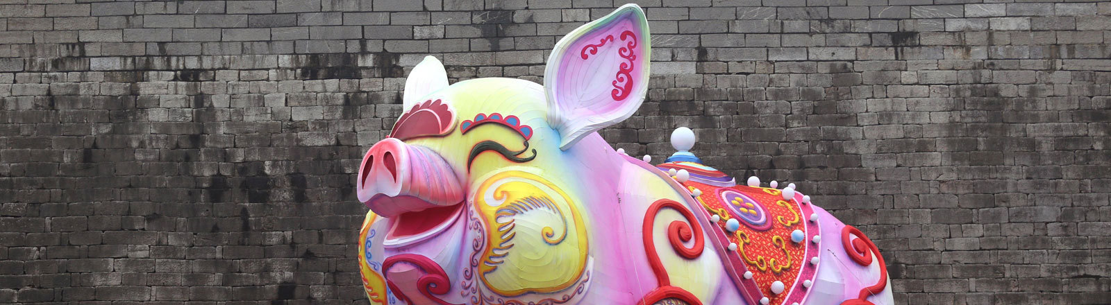 People look at a lantern featuring a pig, which is nearly 10 meters high and 15 meters long, at Nanjing Fuzimiao scenic area for the upcoming Chinese New Year, the Year of the Pig