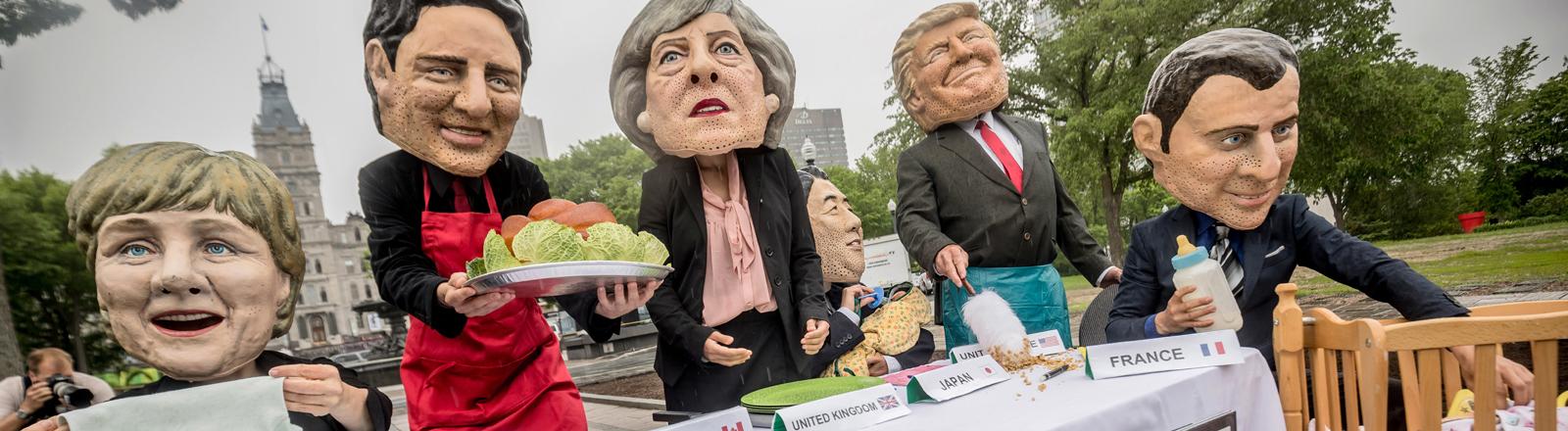 Karikaturen der teilnehmenden Staatschefs beim G7-Gipfel in Kanada.
