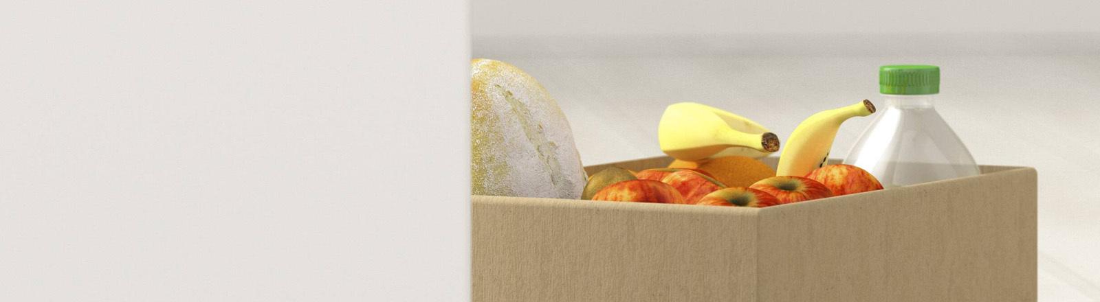 Kiste mit Äpfeln, Bananen, Brot und Wasser