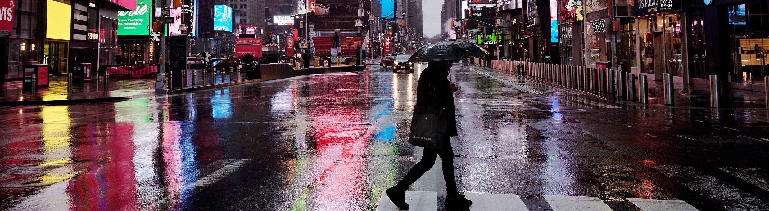 28.03.2020, USA, New York: 6207213 28.03.2020 Lone person crossing street at empty Times Square during the outbreak of coronavirus disease (COVID-19), in New York, United States.