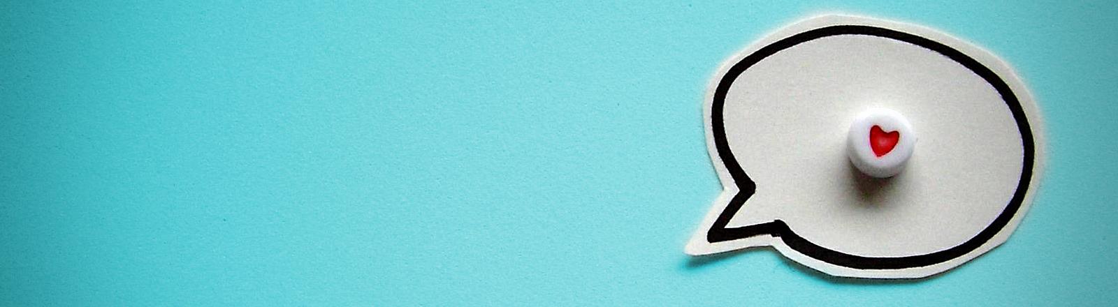 Eine Sprechblase mit einem Herz drin symbolisiert die universelle Sprache der Liebe