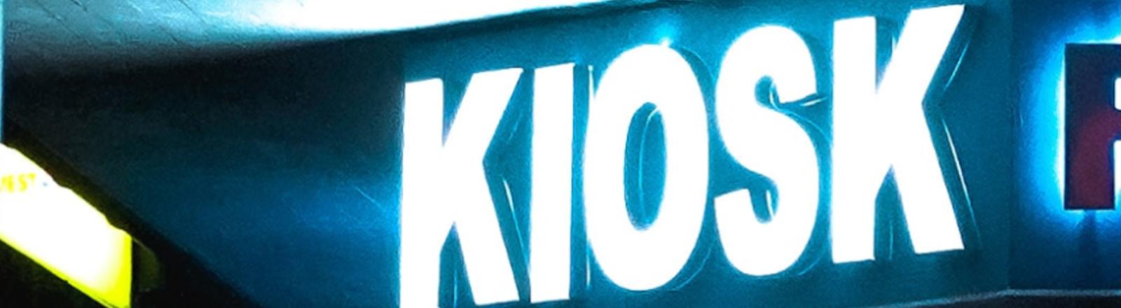 Ein leuchtendes Kiosk-Schild.