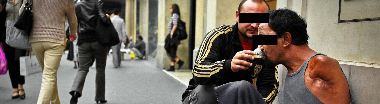 Obdachloser mit Helfer: Straßenszene aus Frankreich – aufgenommen 2010