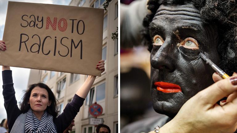 Mann schminkt sein Gesicht schwarz