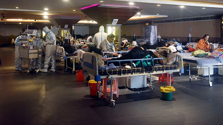 An inside view of the temporary Covid-19 Care Centre set up at Shehnai Banquet Hall attached to LNJP Hospital, on May 3, 2021 in New Delhi, India.