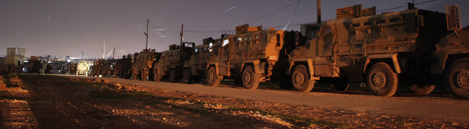 A Turkish military convoy is seen parked near the town of Batabu where the convoy was stationed west of Aleppo.