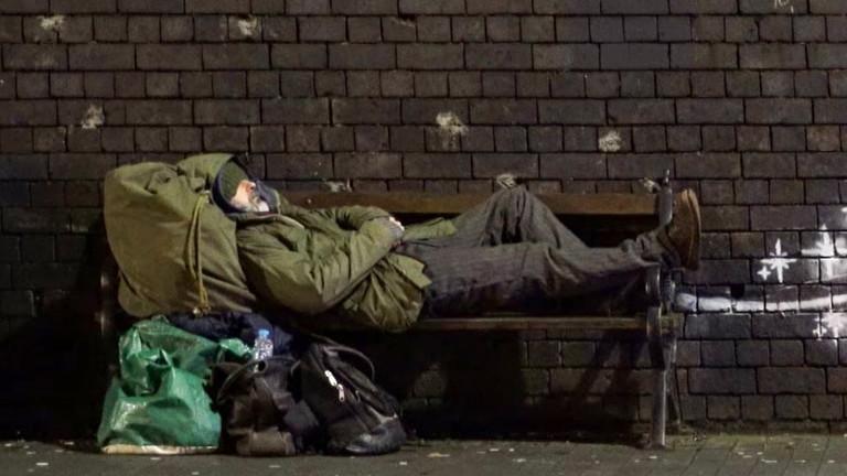 Obdachloser in Rentierschlitten