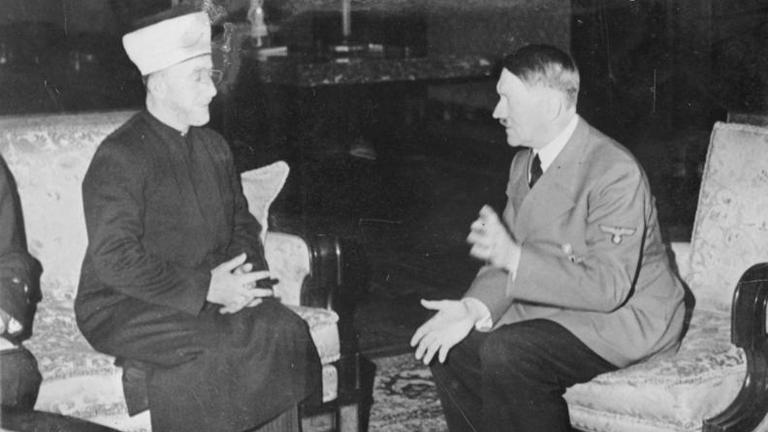 Der Großmufti von Jerusalem, Mohammed Amin al-Husseini, unterhält sich mit Adolf Hitler (28. November 1941)